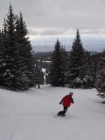 Snowboarder on Camp Robber trail at Ski Santa Fe