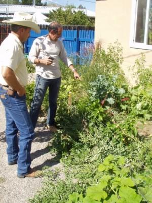 Santa Fe County Extension Agent touring Bob's garden